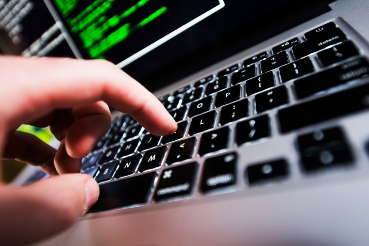 Computer Works. Hand on Laptop Keyboard Closeup. Computer Technologies.
